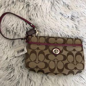 Coach small handbag wristlet